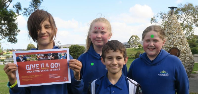 Four kids with sign that says Give it a Go - Cool after school activities