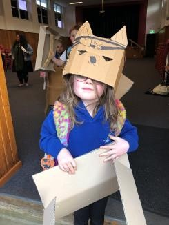 Young girl wearing cat hat at Dover District School