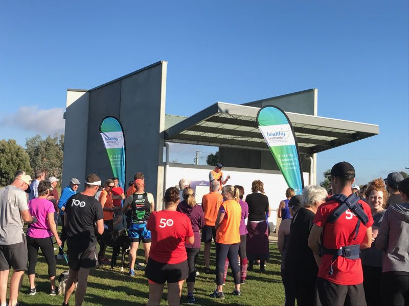 Runners standing outside.  parkrun Inc's parkrun program is a free, weekly event that encourages physical activity, volunteering and community connectedness.