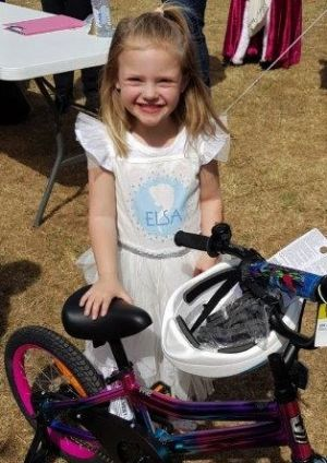 girl with bike - Devonport Community House bicycle winners