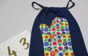 Colourful drawstring bag.