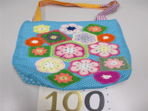 Hand made bag with 100 written below, signifying 100 bags made.